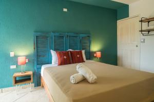 A bed or beds in a room at Selina Playa Del Carmen