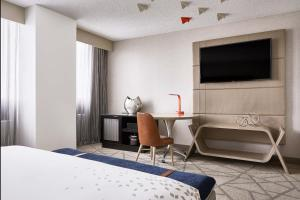 A television and/or entertainment center at Renaissance Denver Central Park Hotel
