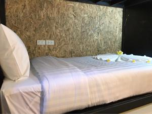 A bed or beds in a room at UBOX Hostel