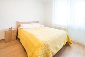 Кровать или кровати в номере Pasha's apartments