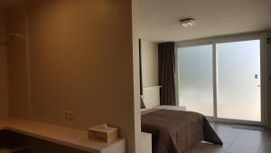 Ein Bett oder Betten in einem Zimmer der Unterkunft B&B Logies Charles Cabour