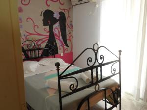 A bed or beds in a room at Villa Giorgos