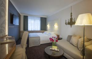 A bed or beds in a room at Boutique Hotel Das Tigra