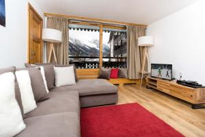 A seating area at Les Balcons du Savoy 104 appt - Chamonix All Year