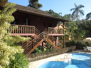 The swimming pool at or near Pousada da Villa Itamambuca