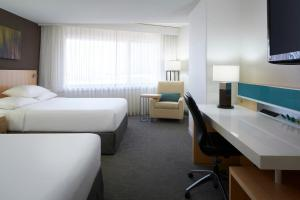 A television and/or entertainment center at Delta Hotels by Marriott Quebec