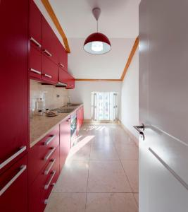 A kitchen or kitchenette at Palácio Camões - Lisbon Serviced Apartments