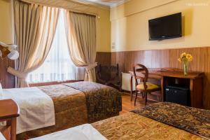 Cama o camas de una habitación en Hotel Panamericano
