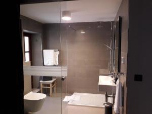 A bathroom at Rialto Residence