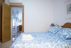 Säng eller sängar i ett rum på Apartamentos Turísticos Fercomar