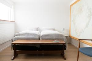 A bed or beds in a room at Natura Apartments