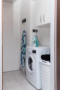 A kitchen or kitchenette at Apartment Lapad Beach