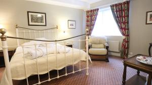 A bed or beds in a room at The Lion Hotel Shrewsbury