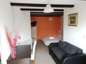 Postel nebo postele na pokoji v ubytování Pansion Villa Cancar