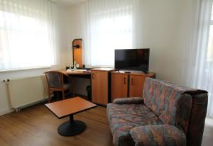 A seating area at Hotel & Restaurant am Rosenhügel