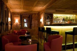 The lounge or bar area at Soldanella by Hotel Adula