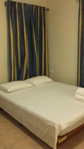 A bed or beds in a room at Ifigeneia