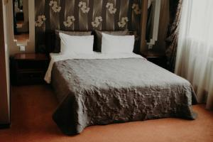 A bed or beds in a room at Bordo Business House