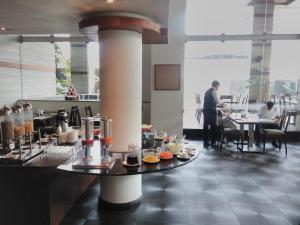 A restaurant or other place to eat at Melange Astris
