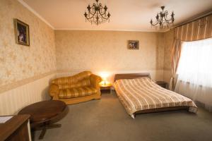 A bed or beds in a room at Magnat Lux Hotel