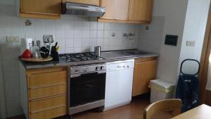 """A kitchen or kitchenette at Appartamento """"La Piccola"""""""