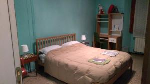"A bed or beds in a room at Appartamento ""La Piccola"""