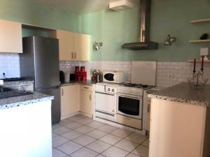 A kitchen or kitchenette at Gites du chateau du Breuil