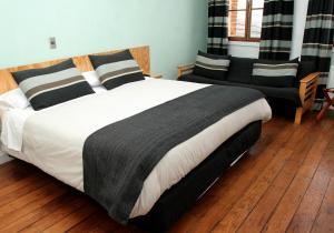 Cama o camas de una habitación en Hotel Ultramar