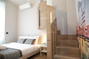 Een bed of bedden in een kamer bij Aparthotel Meneghino