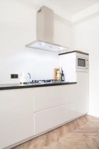 A kitchen or kitchenette at Maison BON Apartments