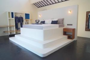 A bed or beds in a room at Stay Shark Villas Gili Air