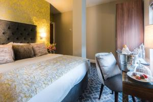 A bed or beds in a room at Shipquay Boutique Hotel