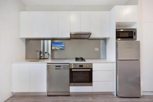A kitchen or kitchenette at Bondi Beach Studio King Suite 1