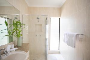 A bathroom at 6 Beachside