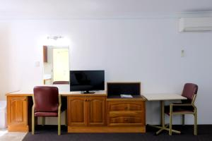 A television and/or entertainment center at Forster Motor Inn