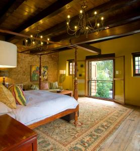 A bed or beds in a room at Cape Heritage Hotel