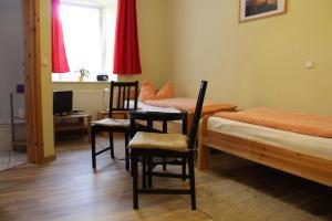 Ein Bett oder Betten in einem Zimmer der Unterkunft Landgasthof Kreinitz