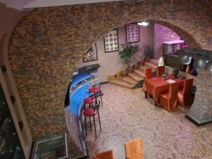 Ресторан / й інші заклади харчування у HOROSHO Guest Villa