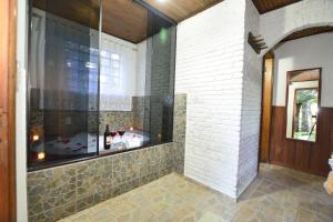 Um banheiro em Hotel Pião Mineiro