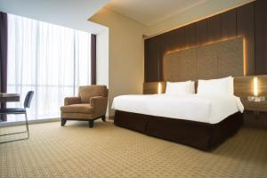 A bed or beds in a room at Grand G7 Hotel