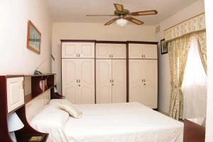A bed or beds in a room at Villa Welcome