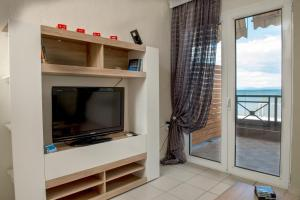 A television and/or entertainment centre at Varka Apartment