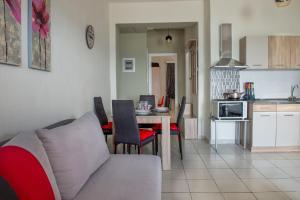 A kitchen or kitchenette at Varka Apartment