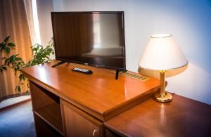 A television and/or entertainment center at Seven Hotel