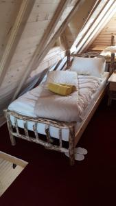 Krevet ili kreveti u jedinici u okviru objekta Bed & Breakfast KUM