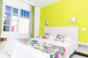 Een bed of bedden in een kamer bij Vista Oasis