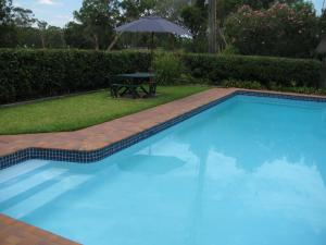 The swimming pool at or near The Wayfarer Motel