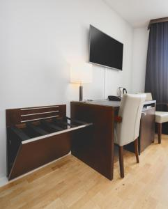 A television and/or entertainment center at Hotel Kea by Keahotels