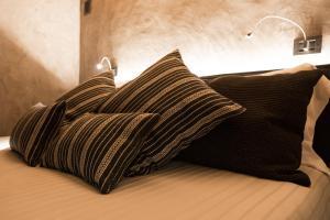 Letto o letti in una camera di Relais Bondaz