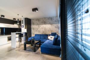 A seating area at LuxApart Kalisz